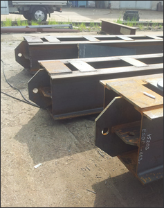 Production and assembly of tie-beams and steel constructions